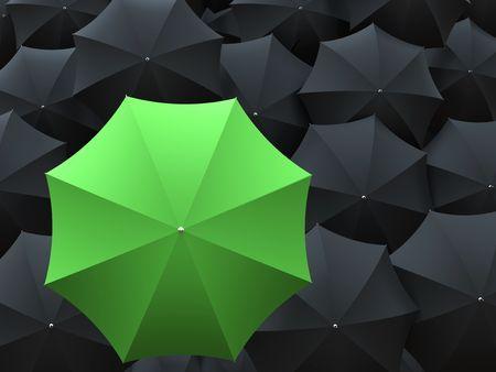 One green umbrella on top of many black umbrellas Stock Photo