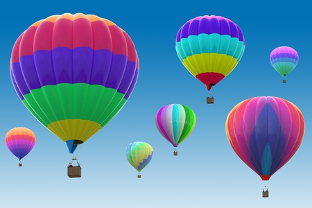 Colorful hot air balloons on blue background photo