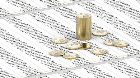 One Dollar coins on spreadsheet Stock Photo - 13226604