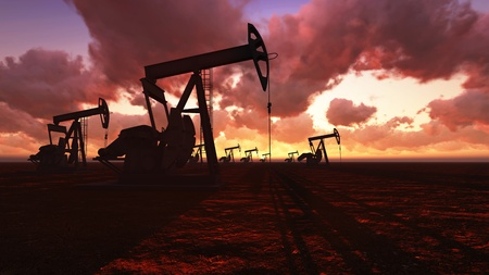 Oil field pump jacks at  sunset photo