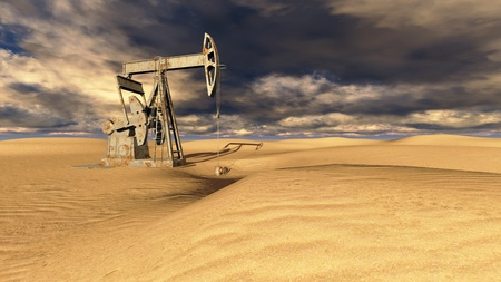 Oil field pump jacks at  sand with dark clouds in background photo