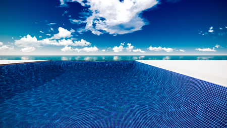 Infinite swimming pool with ocean and clouds in background Stock fotó