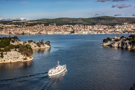Sibenik town and st  Ante channel view from sea photo