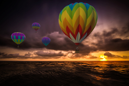 Colorful Hot Air Balloons over sea on sunset photo
