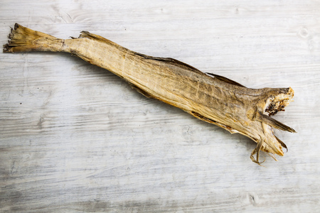 codfish: Dry cod fish on white wooden board
