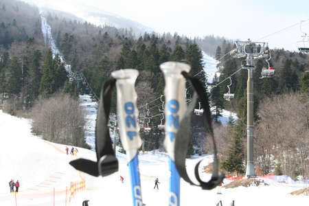 chair lift: Skiing sticks with mountain and chair lift behind