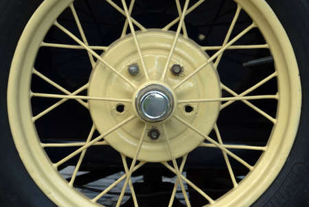 spoked: close up of a old wheel car