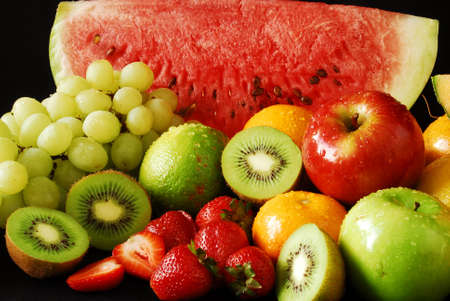 varieties: Colorful fresh group of fruits. Black background.