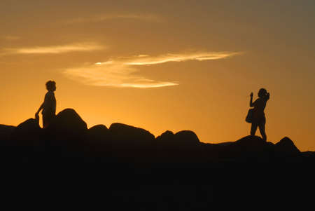 Romantic couple taking a picture at sunset photo