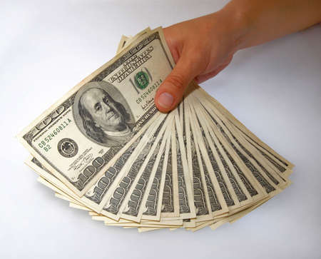 Hand displaying a bundle of hundred-dollar bills photo