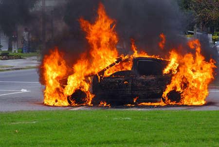 montevideo: Fire burning car at street corner. Montevideo, Uruguay.