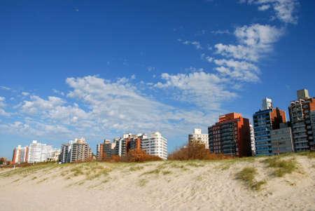 Buildings a sand dune. Punta del Este, Uruguay photo