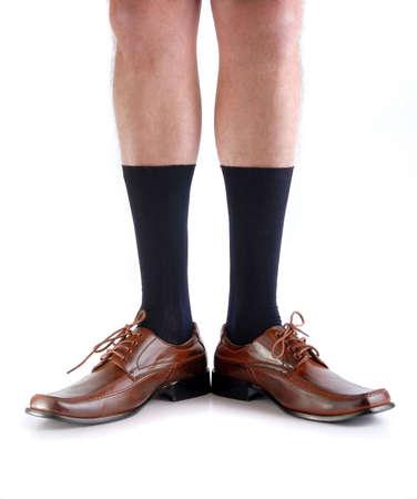 piernas hombre: Las piernas de un hombre de negocios sin sus pantalones. Fondo blanco Foto de archivo