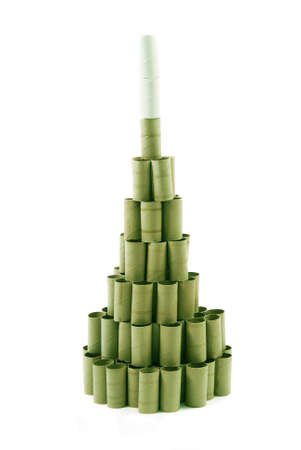 Christmas Tree made with cardboard rolls of toilet paper. Green tones. White background photo