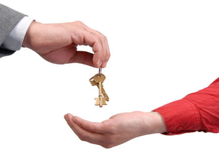 Businessman handing a key to success over a woman palm. Stock Photo - 5847579
