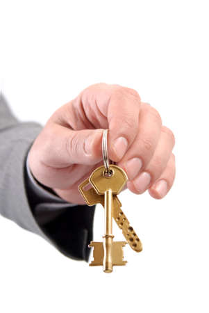 Close-up picture of a male real estate executive's hand holding two keys. Stock Photo - 5847572