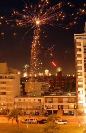 Night scene of Christmas fireworks celebration over the buildings. Montevideo, Uruguay. Stock Photo - 6244118