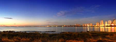 Panoramic golden sunset at Punta del Este seashore city. Uruguay. Stock Photo