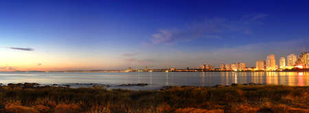 uruguay: Panoramic golden sunset at Punta del Este seashore city. Uruguay. Stock Photo