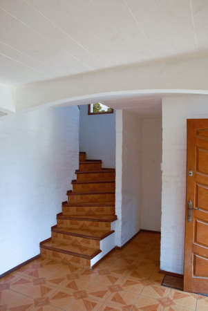 House reception and staircase with smaill window photo