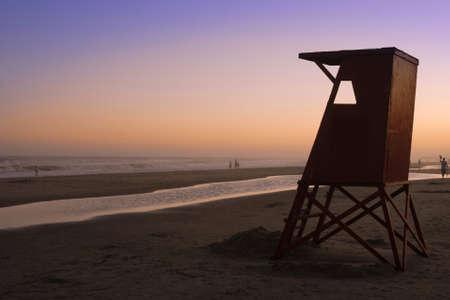 Beautiful quiet sunset at Uruguay beach with lifeguard cabin. Stock Photo - 9174271