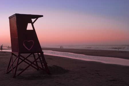 Beautiful quiet sunset at beach. Lifeguard cabin with love sign Stock Photo - 9174272