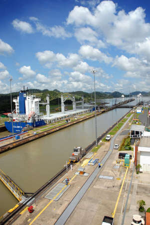 Panama Canal with a large container ship full of cargo in the background