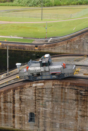 PANAMA – SEPTEMBER 10. Man dirives a Tug locomotive at Miraflores Locks on September 10, 2006 in Panama Canal. Six new locks will be constructed by 2015 on the Panama Canal.