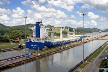 canals: PANAMA – SEPTEMBER 10. Cargo ship crosses locks on September 10, 2006 in Panama Canal. With its unique location at the narrowest point between the Atlantic and Pacific oceans, has had a far-reaching effect on world economic development.