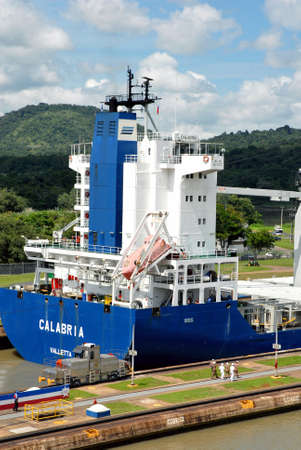 PANAMA � SEPTEMBER 10. Cargo ship crosses locks on September 10, 2006 in Panama Canal. Located at the narrowest point between the Atlantic and Pacific oceans, the Panama Canal has had a far-reaching effect on world economic development.