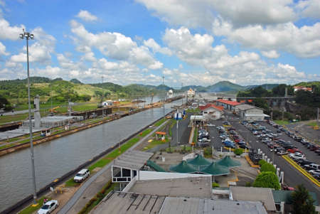 PANAMA � SEPTEMBER 10. Cargo ships leave Locks on September 10, 2006 in Panama Canal. Located at the narrowest point between the Atlantic and Pacific oceans, the Panama Canal has had a far-reaching effect on world economic development