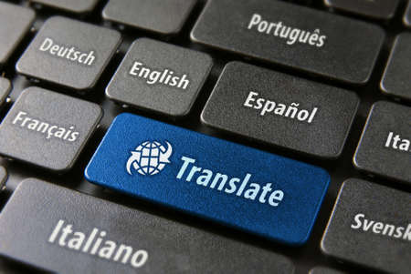 computer language: Multilingual translation online concept. Close up of multi language keyboard and translate word key in blue color with clippingpath. Stock Photo