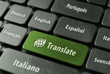 spanish language: Multilingual translation online concept. Close up of multi language keyboard and translate word key in green color with clippingpath.