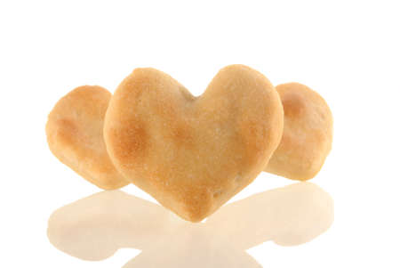 Three heart-shaped cookies isolated and its reflection on white background. Included clipping path, so you can easily cut it out and place over the top of a design. photo