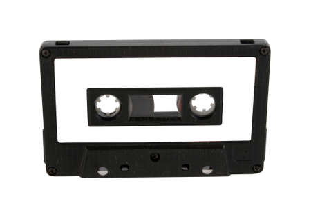 audio cassette: Single black audio cassette and label isolated on white background.