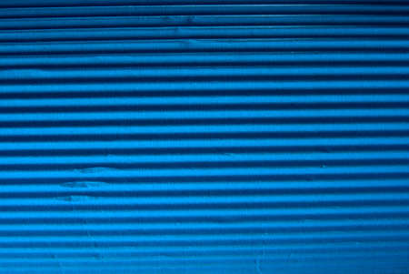 Vintage blue corrugated cardboard macro close up. Useful as background for design works. photo