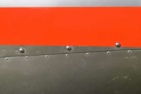 Red and silvel metal texture with rivets and screws  Useful as background for design works  Stock Photo - 14069120