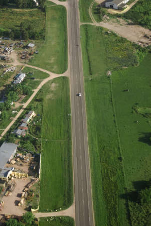 view from above: Aerial view of road in green fields in Uruguay.