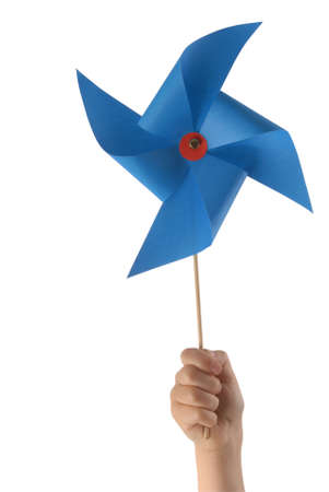 Kid hand holding a blue pinwheel close up isolated on white background. photo