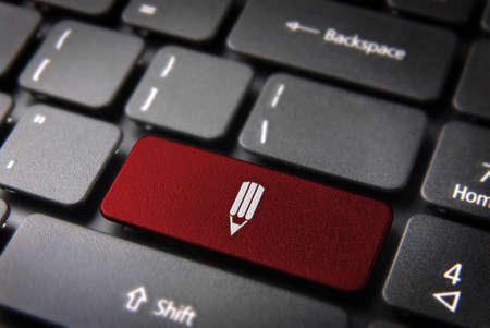 Red school design key with pencil on laptop keyboard  Included , so you can easily edit it  photo
