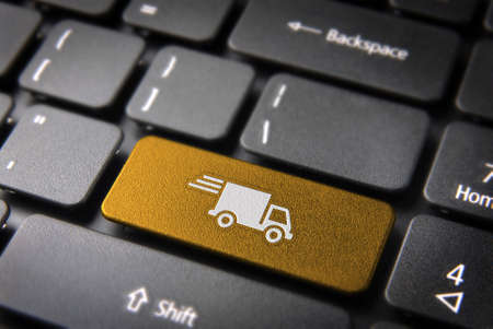 delivery truck: Transport delivery key with truck icon on laptop keyboard  Included , so you can easily edit it  Stock Photo