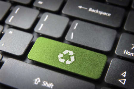 sustainable energy: Go green key with wind turbine icon on laptop keyboard. Included , so you can easily edit it.