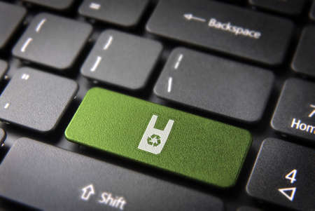 Go green key with recycle plastic bag icon on laptop keyboard. Included , so you can easily edit it. photo