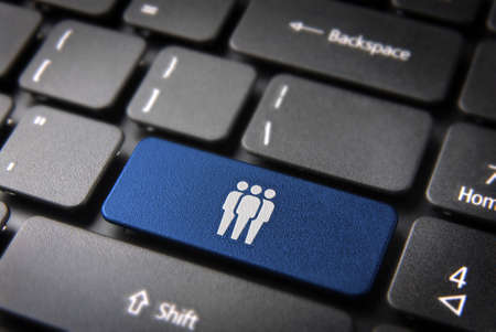 it technology: Human resources key with network team icon on laptop keyboard
