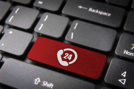 4 7: Online business always open concept: red key with 24 hours phone support symbol on laptop keyboard.