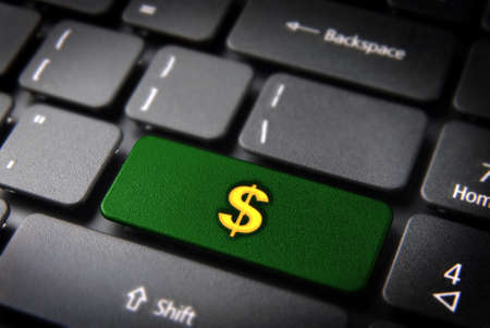Make money with internet  green key with golden dollar currency symbol on laptop keyboard Stock Photo - 15984617