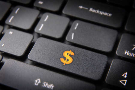 Make money with internet  yellow dollar currency symbol on laptop keyboard   Stock Photo - 15984615