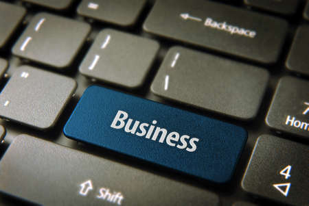 Expand your company with internet: blue key with business word on laptop keyboard. photo