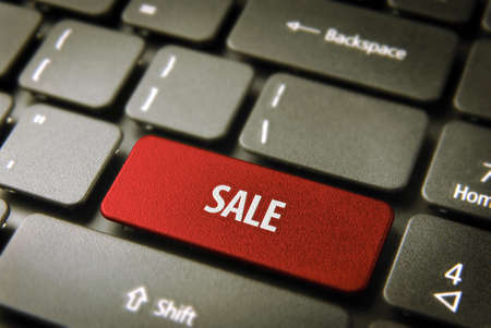 Online shopping season offer  red button with sale text on laptop keyboard Stock Photo - 21599699