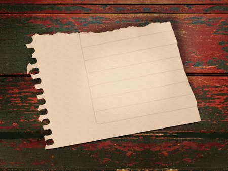 Vintage blank lined paper note over grunge wooden background. Stock Photo - 16651333